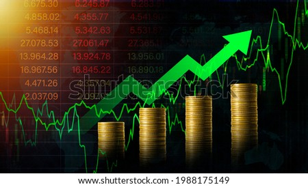 Stock market chart for forex trading graph.Arrow green growing on a golden coins step increase.Business banner background Stockfoto ©