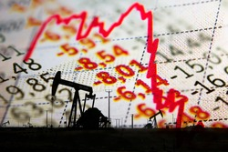 Stock market declining chart and oil pump jack - abstract background