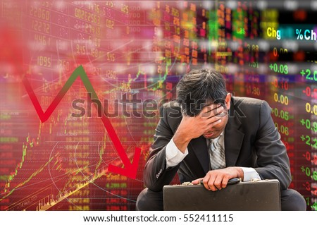 Stock market down trend and despair broker man on graph and number with bearis time all world stock fail background and digital red number on stock board .Business concept of world stock bear market