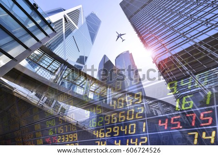 Stock Market Exchange on a skyscraper in Hong Kong background.