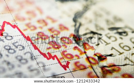 Stock Market Graph and dollar bill. Red trend line indicates the stock market recession
