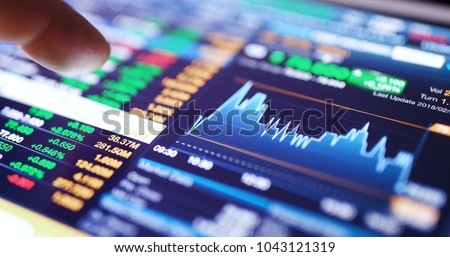 Stock market graph and information showing on digital tablet  Foto d'archivio ©