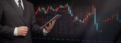 Stock market trading graph, investment candlestick chart. Investor with digital tablet, copy space web banner background