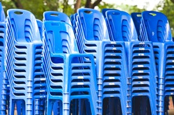 stock of blue plastic chairs