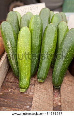 Stock of fresh green squash in vegetable market tray