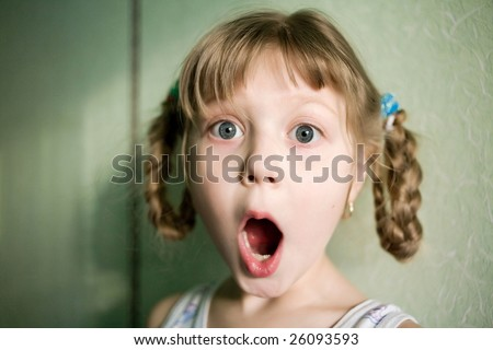Stock photo: an image of a surprised girl with open mouth