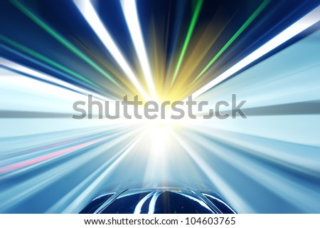 Stock Photo: Car driving fast down interior tunnel