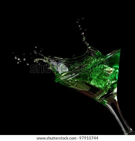 Stock Photo: green martini cocktail splashing into glass - stock photo