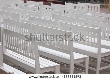 Stock Photo - metal garden chair in beautiful garden