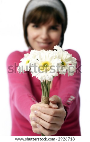 Stock photo of a pretty young  woman offering flowers