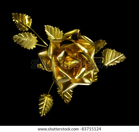 Stock photo of a Shiny metal rose Flower made from brass Isolated silhouette over black background Close-up