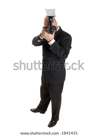 Stock photo of a well dressed wedding photographer.  Full length, isolated on white.