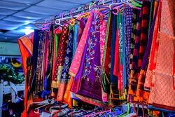 Stock photo of Beautiful colorful Indian saree hung on hanger in the display of saree shop at Kolhapur Maharashtra India.