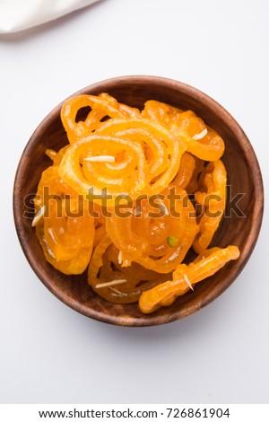 Stock photo of Jalebi or Jilbi or imarati, indian sweet food fried in pure ghee, selective focus