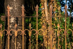 Stock photo of old rusty iron garden fence or old rusty railing at Kolhapur maharashtra India, picture captured under bright sunlight. Focus on object.