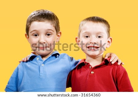 Stock photo of two children over yellow background