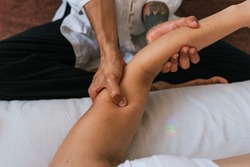 Stock photo of unrecognized person enjoying arm massage in spa.