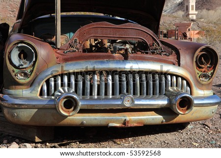 Stock Photo:  Old rusted car in junk yard . National park Death valley