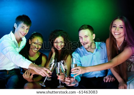 Stock Photo: People  holding the glasses of champagne making a toast