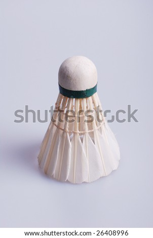 stock photo:shuttlecock on gray floor