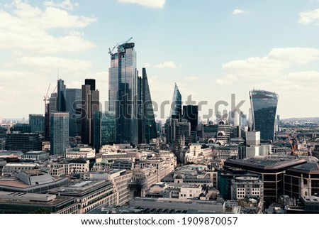 Stock photo taken of the London cityscape from the top of a building to the skyscrapers of the financial district