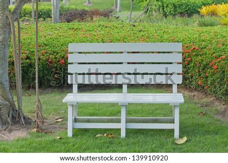 Stock Photo - wooden garden chair in beautiful garden