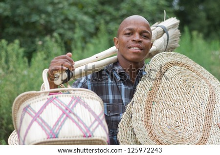 Stock photograph of a black South African entrepreneur small .business broom salesman in Hilton, Pietermaritzburg, Kwazulu-Natal
