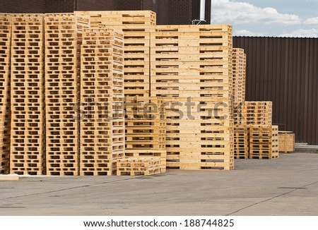 Stock Piles of wooden pallets in a yard ready for breaking up and recycling into firewood or kindling