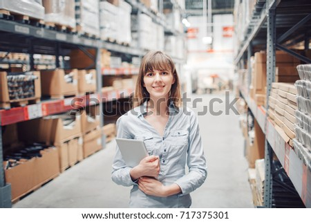 stock taking. beautiful young woman worker of furniture store.