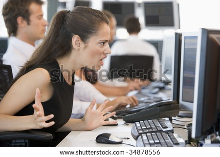 Stock Trader Looking Exasperatedly At Monitor