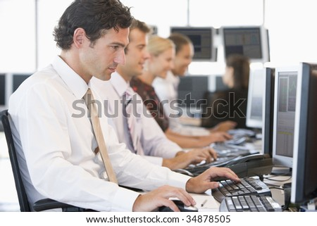 Stock Traders Working At Computers - stock photo