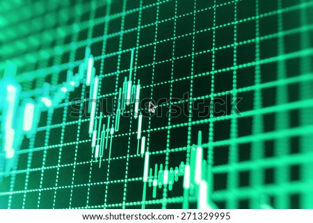 Stock trading chart on monitor screen. Finance background. Green color.