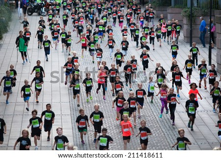STOCKHOLM - AUG, 16: The start of little midnight run for boys and girls. (Midnattsloppet) event. Aug 16, 2014 in Stockholm, Sweden #211418611