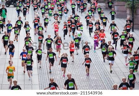 STOCKHOLM - AUG, 16: The start of little midnight run for boys and girls. (Midnattsloppet) event. Aug 16, 2014 in Stockholm, Sweden  #211543936