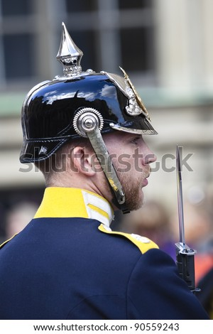 STOCKHOLM - AUGUST 23: A Swedish honorable guard looks into the crowd during the changing of guard ceremony at the royal palace on August 23, 2011, in Stockholm, Sweden.
