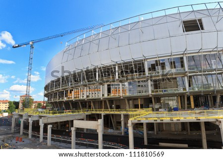 STOCKHOLM - AUGUST 05: Construction of Tele2 Arena on August 5, 2012 in Stockholm, Sweden. The arena will host  30,000 people and fulfill requirements of FIFA and UEFA for international games.