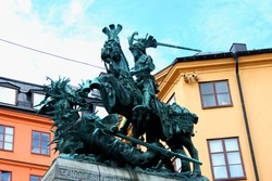 Stockholm. Old sculpture representing a symbol of the city - the knight who has won a dragon