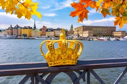 Stockholm old town (Gamla Stan) cityscape and Royal crown in autumn, Sweden