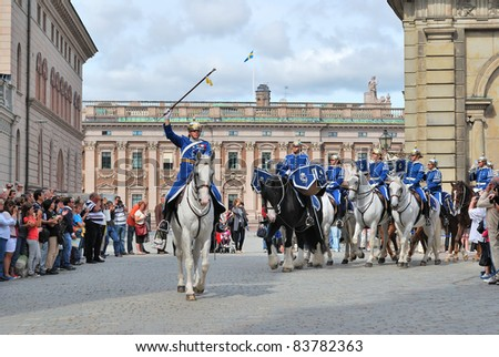 STOCKHOLM, SWEDEN - AUGUST 24: Musicians dress in the uniforms  leave the area in front of the Royal Palace after the traditional changing of the guard ceremony in Stockholm on August 24, 2011