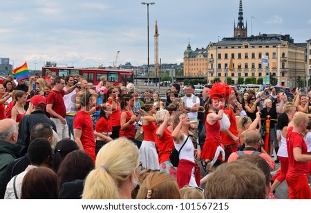STOCKHOLM, SWEDEN - AUGUST 06: Participants and spectators of The gay pride parade on August 06, 2011 in Stockholm, Sweden