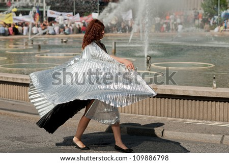 STOCKHOLM, SWEDEN - AUGUST 4: Woman in a fancy dress marching at Stockholm Pride Parade on August 4, 2012 in Stockholm which attracts an estimated 50000 participants and 500000 spectators.
