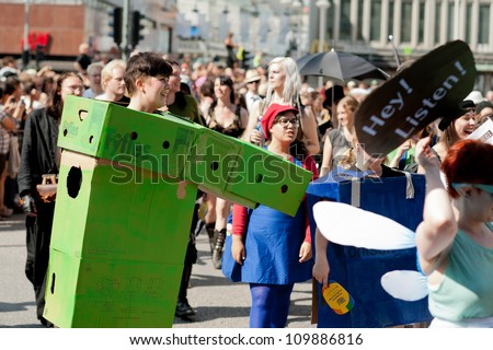 STOCKHOLM, SWEDEN - AUGUST 4: Woman in green box marching at Stockholm Pride Parade on August 4, 2012 in Stockholm which attracts an estimated 50000 participants and 500000 spectators.