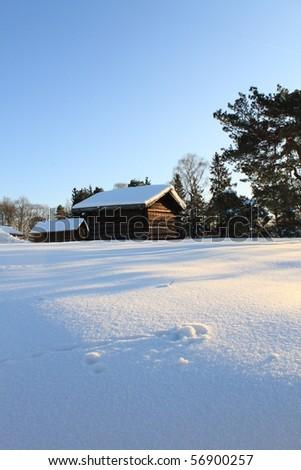 STOCKHOLM, SWEDEN - FEBRUARY 11: Log Cabin in Snow February 11, 2010 in Skansen, Stockholm, Sweden
