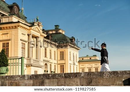 STOCKHOLM, SWEDEN - JULY 27: Royal guard marches at Drottningholm Palace on July 27, 2011 in Stockholm. The palace is the residence of the Swedish Royal family and a UNESCO World Heritage site.