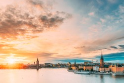 Stockholm, Sweden. Scenic Famous View Of Embankment In Old Town Of Stockholm At Summer. Gamla Stan In Summer Evening. Famous Popular Destination Scenic Place And UNESCO World Heritage Site.