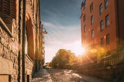 Stockholm, Sweden. Sunshine During Sunset Above Stockholm Street. Beautiful Street With Multi-storey House In Sunny Summer Evening. Cozy Side Street.