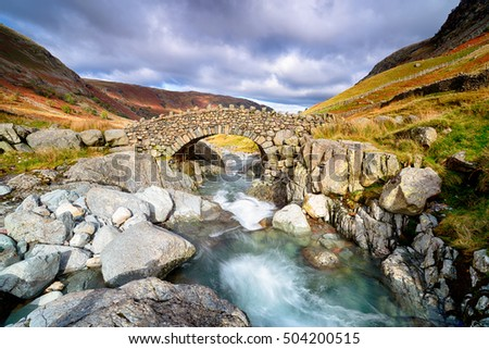 Stockley Bridge crossing the river Derwent near Seathwaite in the Lake District National Park in Cumbria.