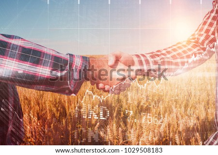 Stocks and shares against cropped image of human hand shaking