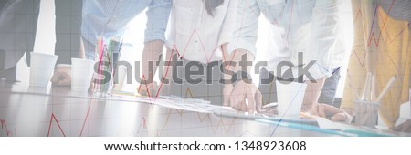 Stocks and shares against serious photo editors looking at photos