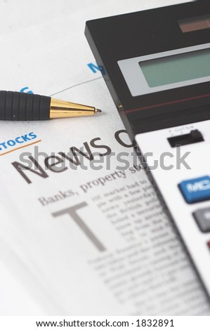 Stocks News, pen, calculator, banks, property headlines, shallow depth of field, vertical orientation